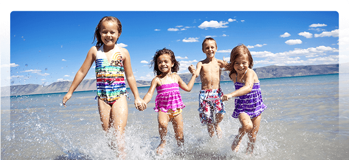 Children running in the water - Pediatric Dentist in Poway, CA